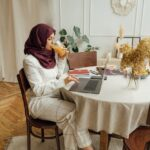 woman in a hijab using a laptop